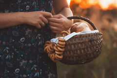 Beautiful young woman with a basket full of fresh baked bread Stock Images