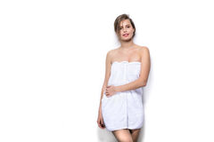 Beautiful young woman with bath towel on the body Stock Photography
