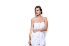 Beautiful young woman with bath towel on the body Royalty Free Stock Photography