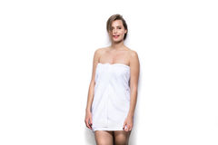 Beautiful young woman with bath towel on the body Royalty Free Stock Photo