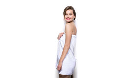Beautiful young woman with bath towel on the body Royalty Free Stock Photos