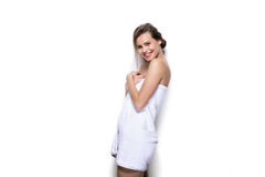 Beautiful young woman with bath towel on the body Royalty Free Stock Images