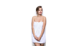 Beautiful young woman with bath towel on the body Stock Images