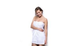 Beautiful young woman with bath towel on the body Stock Photo