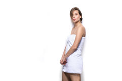 Beautiful young woman with bath towel on the body Royalty Free Stock Image