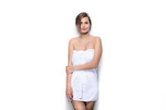 Beautiful young woman with bath towel on the body Stock Image
