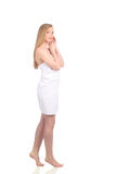 Beautiful young woman after bath with towel isolated on white background Royalty Free Stock Image
