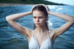 Beautiful young woman bathing in the sea in a swimsuit, vacation, beach, sun, summer Stock Photography