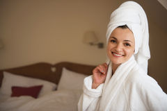 Beautiful young woman in bathrobe Royalty Free Stock Images