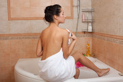 Beautiful young woman in a bathroom. Stock Photos