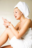 Beautiful young woman in the bathroom Royalty Free Stock Image