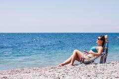 Beautiful young woman on the beach. Beautiful young woman in glasses on the beach Stock Photography
