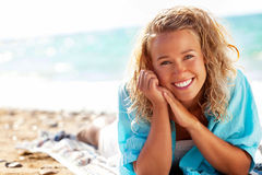 Beautiful young woman on the beach. Close-up of a beautiful young woman on the beach Stock Images