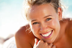 Beautiful young woman on the beach. Close-up of a beautiful young woman on the beach Stock Image