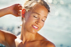Beautiful young woman on the beach. Close-up of a beautiful young woman on the beach Stock Photos