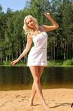 Beautiful young woman on the beach Royalty Free Stock Photo