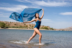 Beautiful young woman by the beach Royalty Free Stock Photography