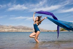Beautiful young woman by the beach Royalty Free Stock Images