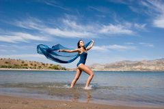 Beautiful young woman by the beach Stock Photography