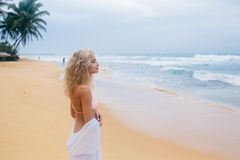 Beautiful young woman on beach Royalty Free Stock Images