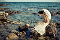 Beautiful young woman on the beach. Ocean Royalty Free Stock Photography