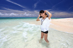 Beautiful young woman on the beach Stock Photography