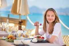 Beautiful young woman in a beach restaurant Stock Photos