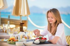 Beautiful young woman in a beach restaurant Royalty Free Stock Image