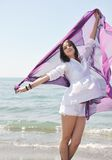 Beautiful young woman on beach with scarf Royalty Free Stock Photography