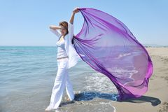 Beautiful young woman on beach with scarf Royalty Free Stock Image