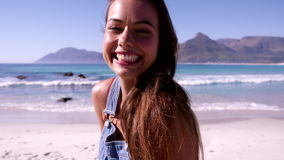 Beautiful young woman on the beach stock footage