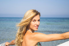 Beautiful young woman on beach at sunny day, portrait, face Stock Images
