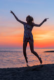 Beautiful young woman on beach at sunset Royalty Free Stock Photo