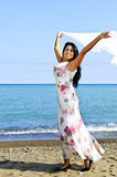 Beautiful young woman at beach with white scarf Royalty Free Stock Photo
