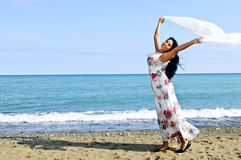 Beautiful young woman at beach with white scarf Royalty Free Stock Images