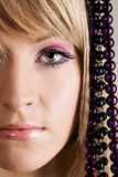 Beautiful young woman with beads Royalty Free Stock Photos