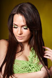 Beautiful young woman in beads. Royalty Free Stock Photos