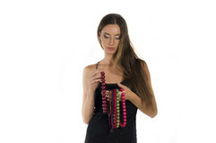 Beautiful young woman with with beads Royalty Free Stock Photography