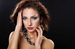 Beautiful woman. Beautiful young woman in beautiful jewelry Royalty Free Stock Photo