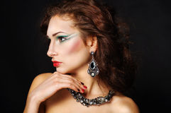 Beautiful woman. Beautiful young woman in beautiful jewelry Royalty Free Stock Photos
