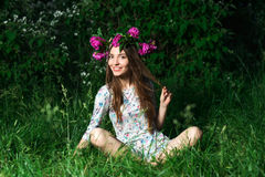 Beautiful young woman with beautiful legs in green spring grass Stock Photography
