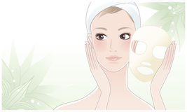 Beautiful young woman after beauty mask on lotus. Beautiful girl, young woman touching her face after beauty mask on the green lotus flower background. Skin care Stock Photo