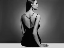 Beautiful young woman.beauty sitting girl Girl with a necklace on her back Stock Photography