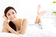 Beautiful young  woman  on the bed Royalty Free Stock Image