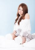 Beautiful young woman in a bed Royalty Free Stock Photography