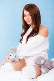 Beautiful young woman in a bed Royalty Free Stock Photos