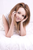 Beautiful young woman in bed Stock Image
