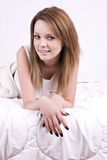 Beautiful young woman in bed Royalty Free Stock Photos