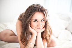Beautiful young woman in bedroom Stock Photo
