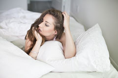 Beautiful young woman in bedroom Royalty Free Stock Image